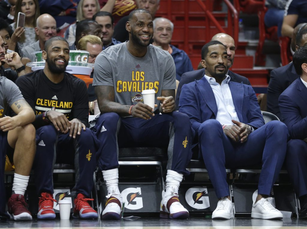 Cavs sitting on the bench during a game.